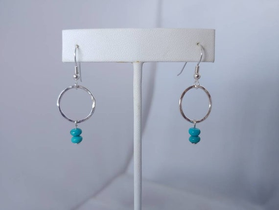 Blue Turquoise disc wire wrapped on hammered sterling circles on sterling French wires with rubber stoppers.