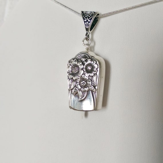 April 1950 upcycled knife handle bell necklace!