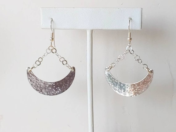 Sterling hammered Quarter Moon shaped textured earrings dangle from chain french wires.
