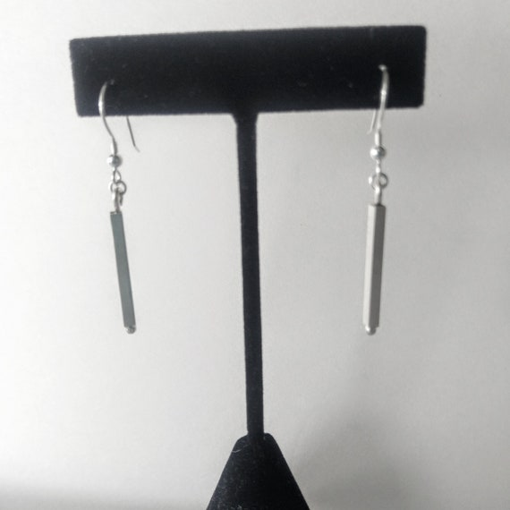 Short square bar sterling silver dangle earrings. Square bar hangs from sterling silver french wire earwires.