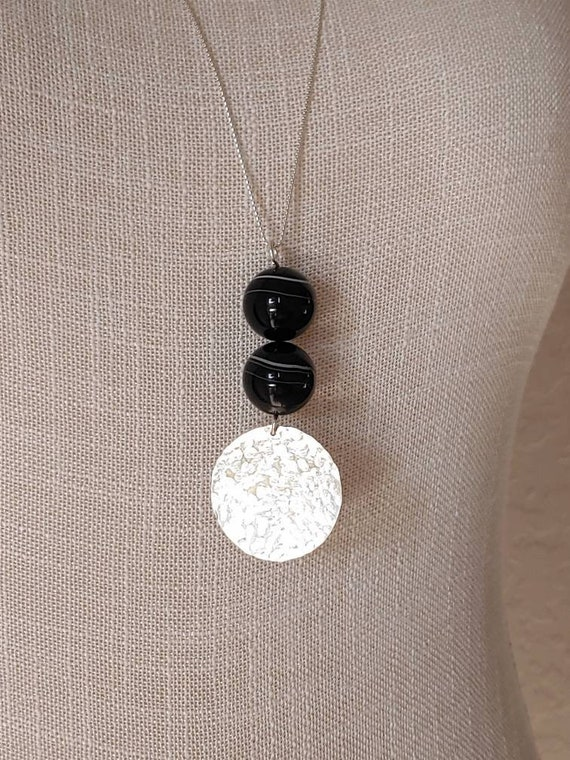 Classy black!  White stripe black agate beads with hammered sterling silver disc 36""