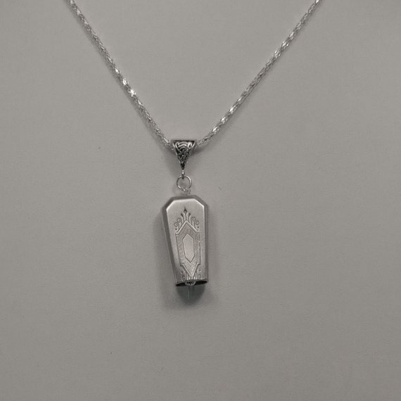 NuArt 1932 upcycled knife handle bell necklace!