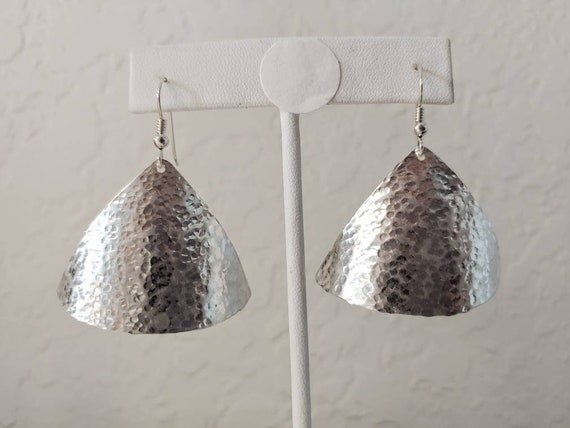 Sterling small dimpled textured triangles dangle from french wires.