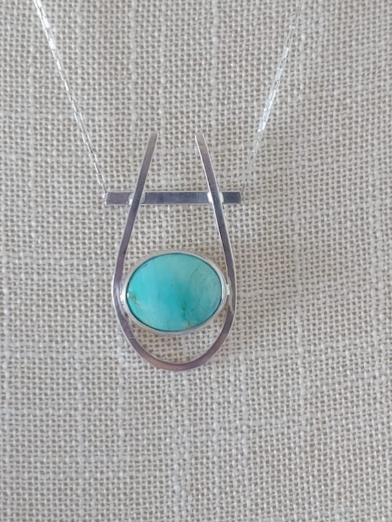 Kingman Mountain Turquoise cradled in sterling silver setting.