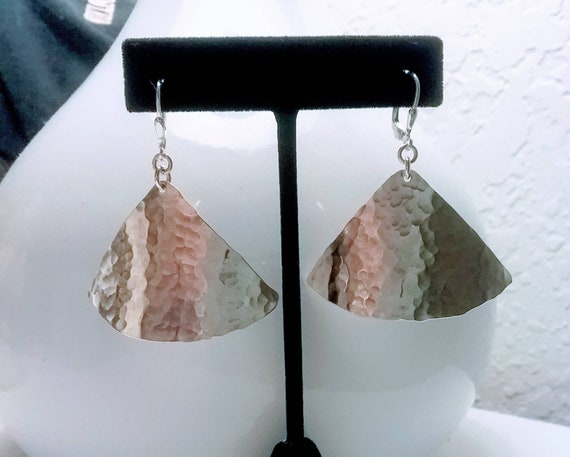 Sterling textured triangles dangle from lever back wires.