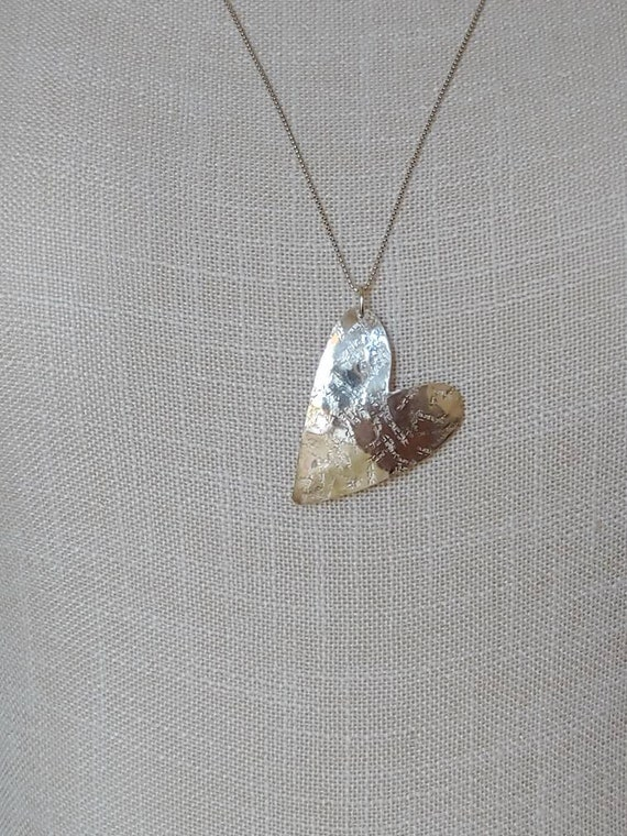 Whimsical sterling heart.  Silk textured with slight bend.  Jewelry for Valentine's Day!  Chain length options!