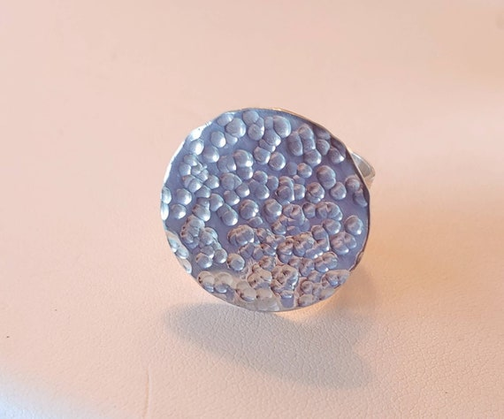 Sterling hammered disc shape on textured ring shank.  Size 7.5 to 7.75