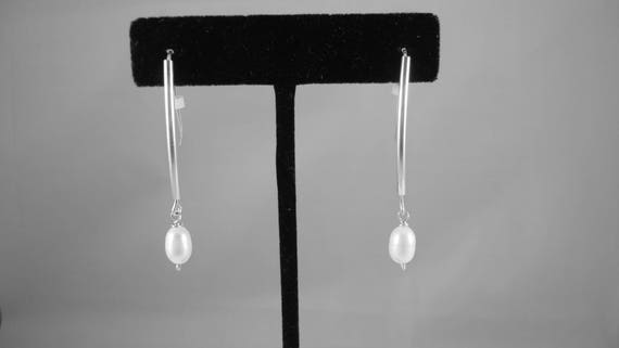 Freshwater Pearl dangle earrings.  Pearls hang from sterling silver tubes with self made earwires