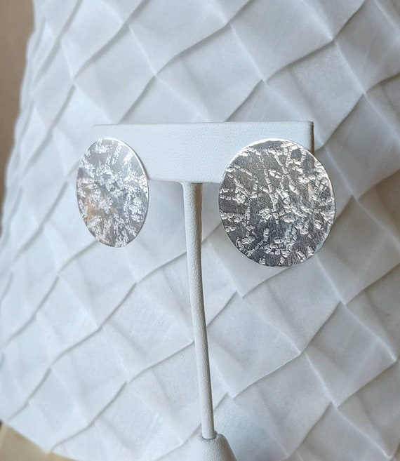 Silk hammer textured round sterling silver post earrings. Lightweight. Sterling posts and backs.