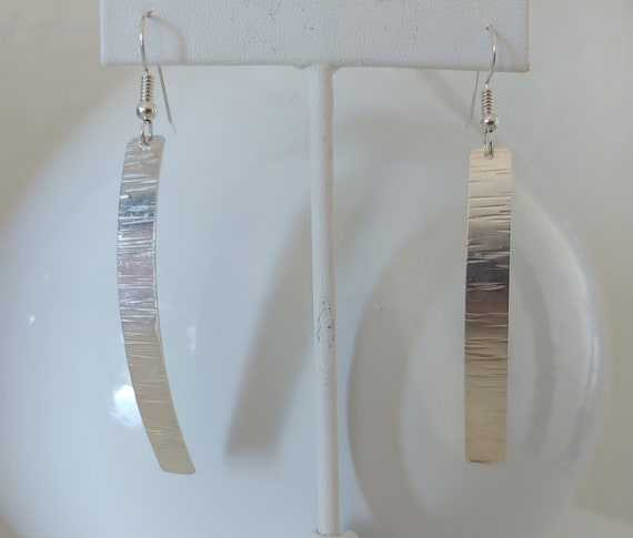 Long textured rectangle bar sterling silver dangle earrings.  Hangs from sterling silver french wire earwires.