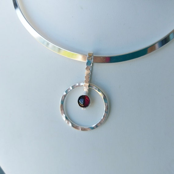 Blue topaz, Ruby, Lapis, Garnet, or Amethyst gemstone in bezel on SS circle.  SS Collar is best fitting you'll ever wear!