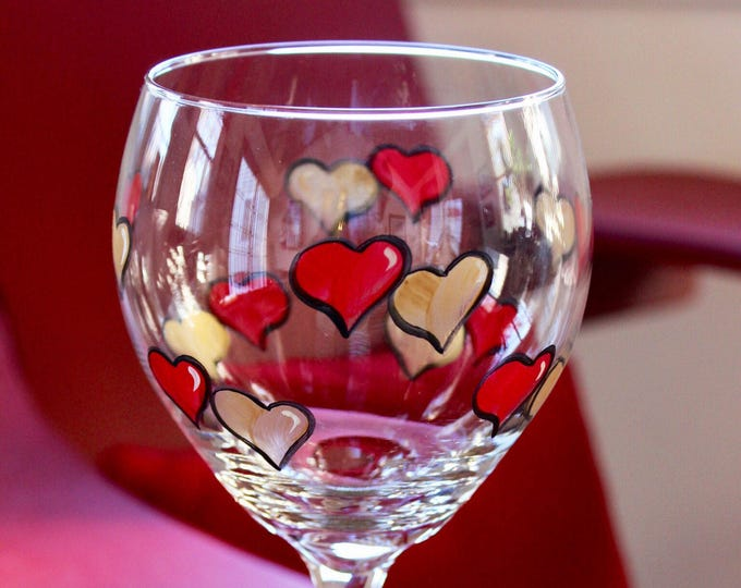 Red and gold hearts hand painted wine glass.