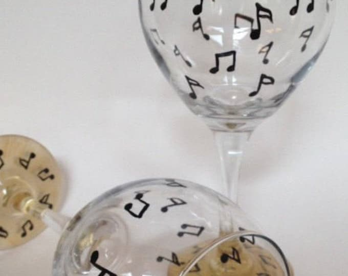 Musical note hand painted wine glasses. Set of 2