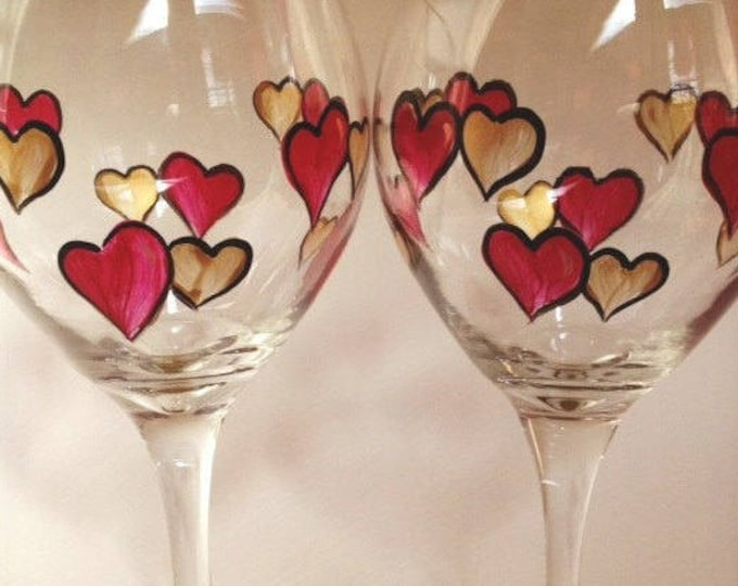 Anniversary hearts hand painted wine glasses.  Set of 2