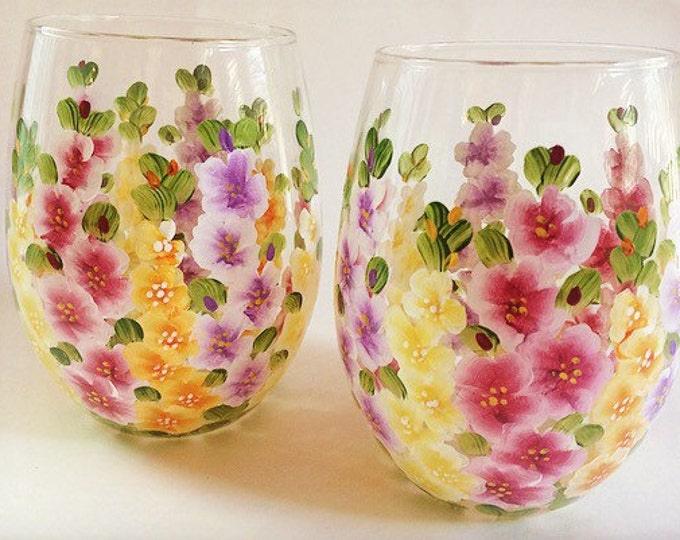 Gladiolas hand painted on two stemless wine glasses.  Made in USA.