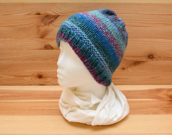 Knitted hat in variegated blue and pink yarn