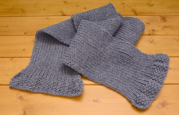 Child's knitted blue scarf with flared ends