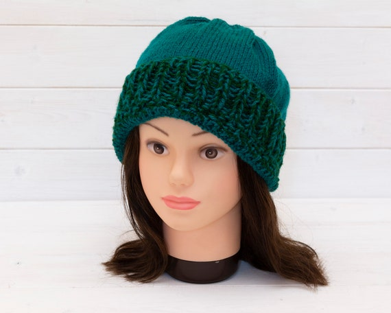 Teal knitted hat with green ribbed brim