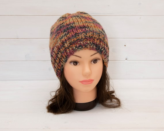 Reversible knitted hat in brown, red, orange, black mix