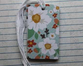 27 gift tags white/yellow flowers blue patterned paper over chipboard
