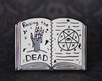"2"" Hard Enamel Pin Raising the Dead Book"