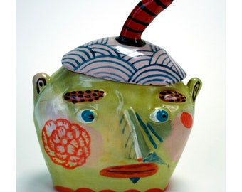 Jar. Head with Beret and Flower Tatoo.