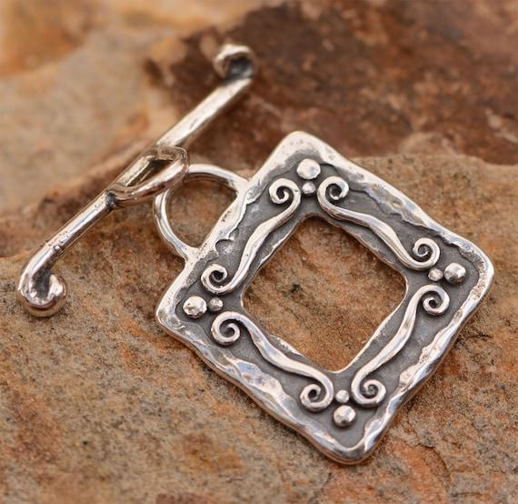 sterling silver swirl clasp