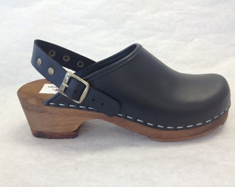 Lana LH // Black oiled Low heel clog with ankle strap and bronze studds and buckle