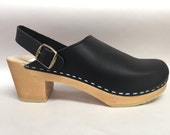 Lana // Black oiled medium heel clog on natural with ankle strap and bronze buckle