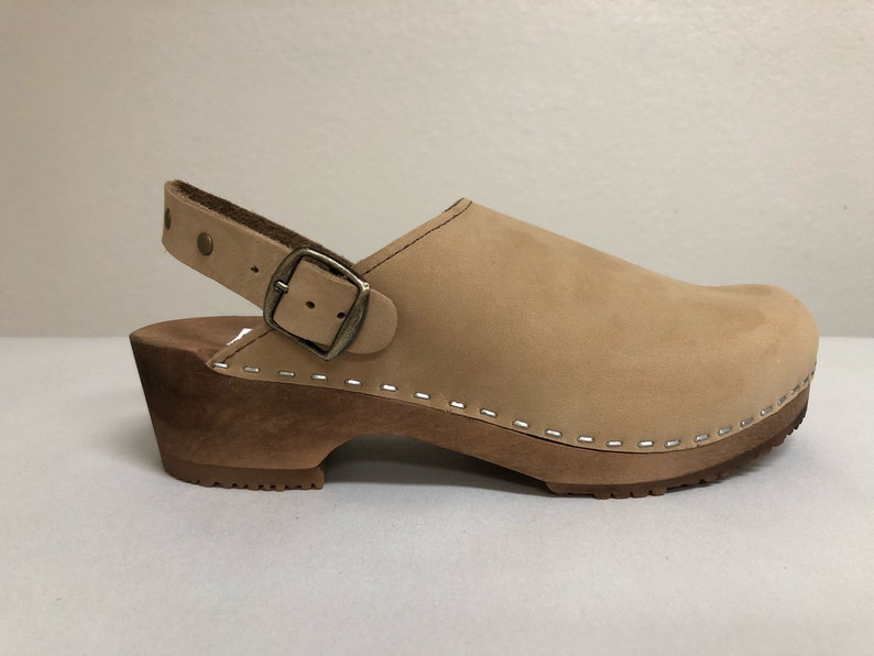 Nude nubuc Low heel clog with ankle strap and bronze studds image 0