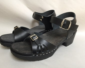Black leather sandal on a BLACK comfort base with a buckled ankle strap