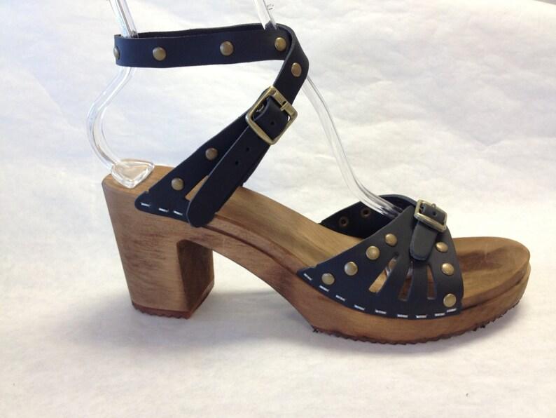 2e4e00640b131 Super High Heeled Black leather sandal and bronze studds