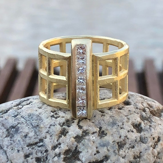 Grid Ring in 18kt Gold w/3/8ctw Princess Diamonds in a Sturdy Channel Set Bar