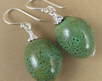 Green ceramic earrings. Large oval shape. Sterling silver. Handmade.