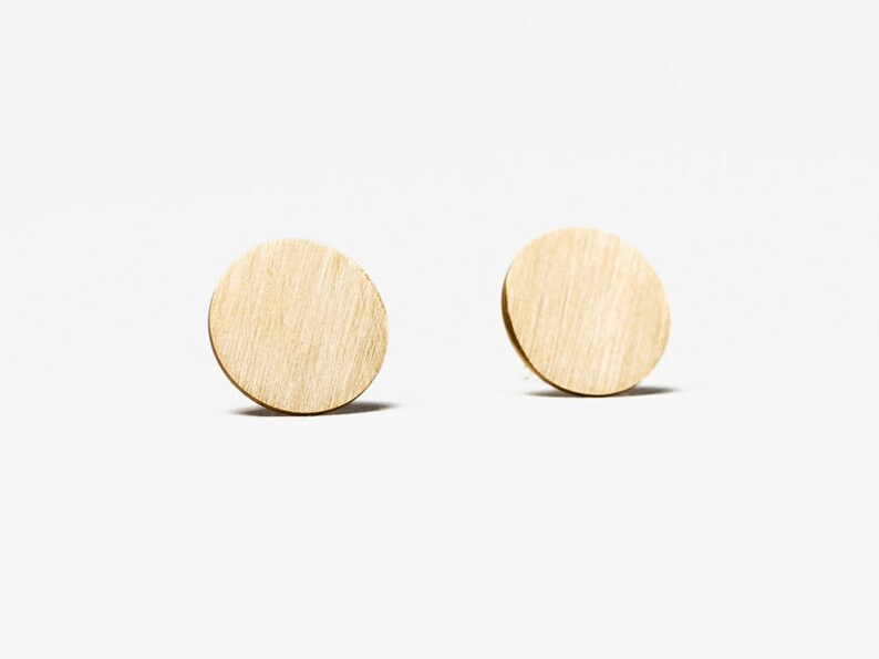 Stud earrings gold // brass disc and silver studs image 0