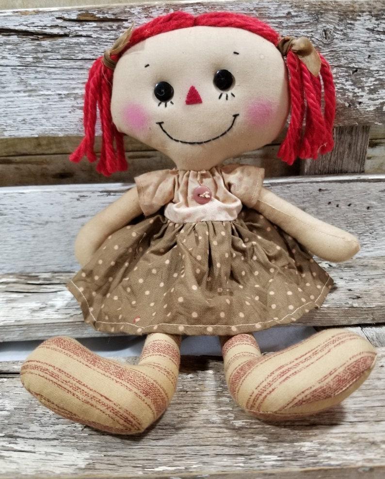 Raggedy Annie Sandy Annie Primitive Doll Raggedy Ann Brown And image 0