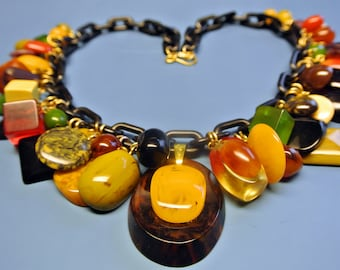 Rare unique ONE-OF-A-KIND necklace with 47 multicolor pendants of genuin tested vintage 1940s bakelite plastic with black plastic chain