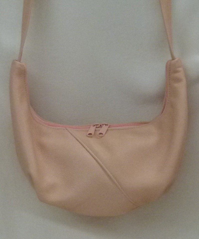3d3419986e9d Small Hobo Sling Bag by Grizzly Creek - peach