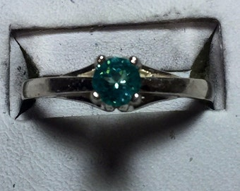 Small apatite and silver ring