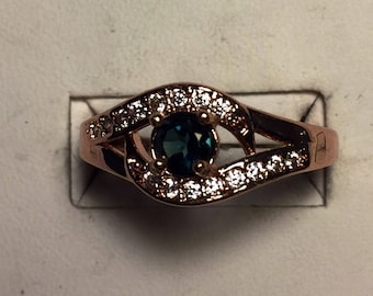 Deep blue green Tourmaline set into rose fold filled ring