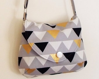 Crossbody bag with adjustable strap, triangle bunting print in gold, grey, black and white, festival bag