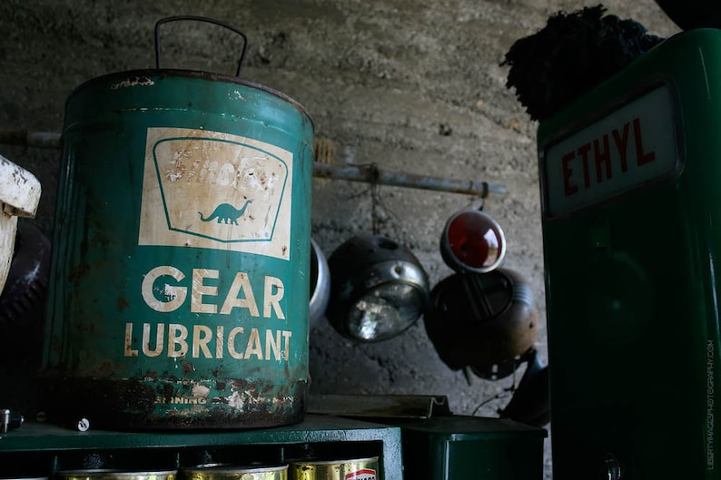 Gritty Garage Photo Wall Art  Old Green Sinclair Dino Can In image 0