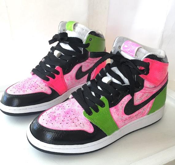 black jordans with pink bottom