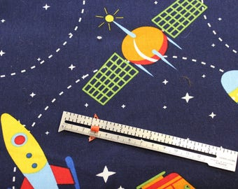 "Flying Rockets on navy 100% cotton fabric 42-44"" wide"