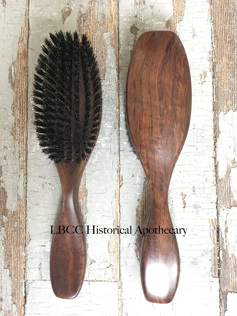 1940s Hairstyles- History of Women's Hairstyles 19th-20th Century Medium-Hard Boar Bristle Hair Brush Historical Hairbrush Toilette Accessories Victorian Hair Brush Edwardian Hair Brush $69.00 AT vintagedancer.com