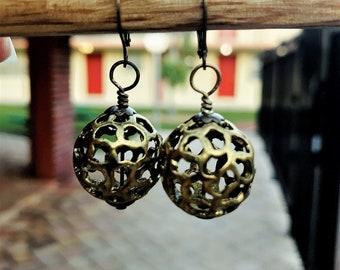 Mod Gold Toned Metal Lattice Ball Earrings