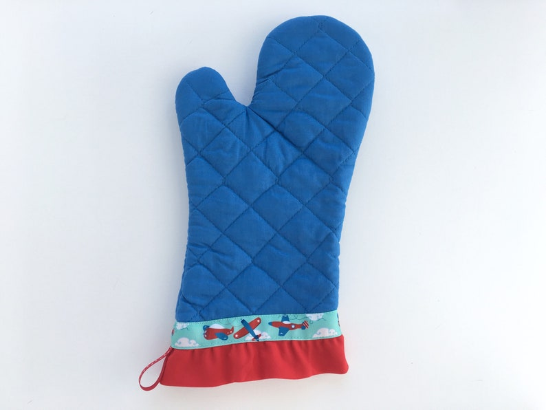 Airplane Oven Mitt. Blue Kitchen Pot Holder with Red Ruffle. image 0