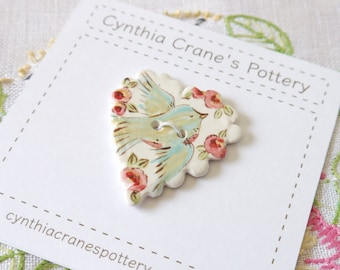 Large Ceramic Porcelain Heart Button with Scalloped Edge, Painted Blue Bird with Red and Pink Flowers