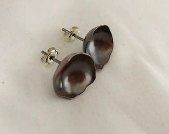 Hammered, free form, copper, concave dome studs with sterling silver posts and ear backings
