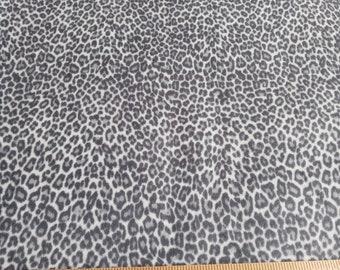 fuzzy grey leopard print stretch knit fabric